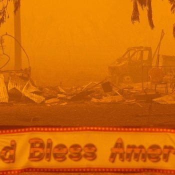 3 missing as huge California fire rages. Some armed residents tell authorities they won't evacuate.
